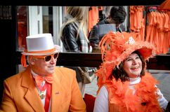 Free Amsterdam, Netherlands - April 27, 2019: Middle-aged Couple Dressed In Classy Orange Costumes Celebrating The Kings Day, Stock Photography - 177757832