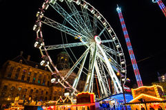 AMSTERDAM,NETHERLANDS-APRIL 27: Attractions on Dam Square at night during King's Day on April 27,2015 in Amsterdam. Royalty Free Stock Photo