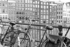 Bicycle and typical architecture in Amsterdam, Netherlands Stock Images