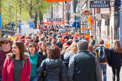 AMSTERDAM,NETHERLANDS-APRIL 27: Busy street around red light district on King's Day on April 27,27 in Amsterdam. Stock Photos