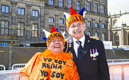 AMSTERDAM, NETHERLANDS - APRIL 30: Couple celebrating the corona Royalty Free Stock Photography