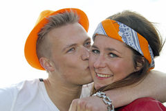 AMSTERDAM, NETHERLANDS - APRIL 30: Couple celebrating the corona Royalty Free Stock Photo