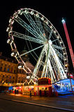 AMSTERDAM,NETHERLANDS-APRIL 27:  Dam Square at night with amusement park on April 27,2015 in Amsterdam. Stock Image