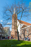 Amsterdam, Netherlands-April 30: The English Reformed Church at famous Begijnhof, tourists go sightseeing on April 30,2015. Stock Photos