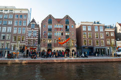 AMSTERDAM, NETHERLANDS-APRIL 27, 2015: Famous Amsterdam Bulldog coffeeshop and hotel in red-light district on King's Day. Royalty Free Stock Photography