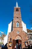 Amsterdam, Netherlands-April 30: Fasade of the English Reformed Church at Begijnhof tourists go sightseeing on April 30,2015. Royalty Free Stock Image