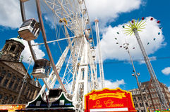 AMSTERDAM,NETHERLANDS-APRIL 27: Ferris wheel on Dam Square during King's Day on April 27,2015 in Amsterdam. Stock Images