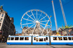 AMSTERDAM,NETHERLANDS-APRIL 27: Ferris wheel with Royal Palace in the background on Dam Square on the eve of King's Day. Stock Images