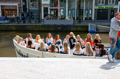 AMSTERDAM,NETHERLANDS-APRIL 27: Group of girls in a boat celebrate King's Day on April 27,2015 in Amsterdam, the Netherlands. Stock Image