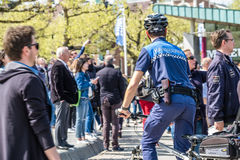 Amsterdam , Netherlands - April 31, 2017 : The handhaving police department having a look in the streets of the city Stock Photos