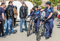 Amsterdam , Netherlands - April 31, 2017 : The handhaving police department having a look in the streets of the city Stock Photography