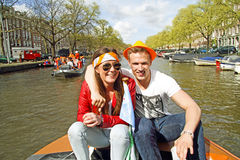 AMSTERDAM, NETHERLANDS - APRIL 30: Happy couple celebrating the Stock Photo