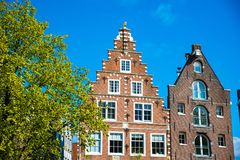House architecture in Amsterdam. Traditional old dutch buildings. Royalty Free Stock Photography