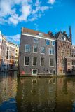 House architecture in Amsterdam. Traditional old dutch buildings. Royalty Free Stock Photo