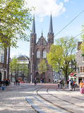AMSTERDAM,NETHERLANDS-APRIL 27: Krijtberg Kerk facade in the distance on King`s Day on April 27,2015 in Amsterdam, Netherlands. Royalty Free Stock Images