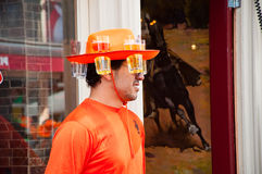 AMSTERDAM,NETHERLANDS-APRIL 27: Local in orange on the street on King's Day on April 27,27 in Amsterdam. Stock Images