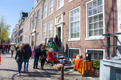 AMSTERDAM,NETHERLANDS-APRIL 27:  Locals display bric-a-brac outside their homes for sale on King's Day on April 27, 2015. Royalty Free Stock Photo