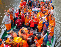 AMSTERDAM,NETHERLANDS-APRIL 27: Locals dressed in orange celebrate King's Day on a boat on April 27,2015 in Amsterdam. Royalty Free Stock Photography