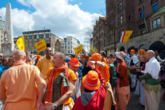AMSTERDAM,NETHERLANDS-APRIL 27: Locals and tourists in orange celebrate joyously King's Day on April 27,2015 in Amsterdam. Stock Photo