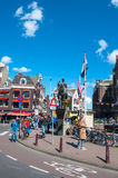 Amsterdam, Netherlands-April 30: Monument of Queen Wilhelmina, crowd of people and tourists on the street on April 30,2015. Stock Photos