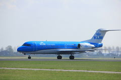 Amsterdam the Netherlands - April 2nd, 2017: PH-KZP KLM Cityhopper. Fokker F70 takeoff from Polderbaan runway, Amsterdam Airport Schiphol Stock Photos