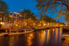 AMSTERDAM, NETHERLANDS - APRIL 4, 2008: Old houses along canal a royalty free stock photography