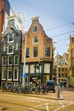 AMSTERDAM, NETHERLANDS, APRIL, 23 2018: Outdoor view of black wooden house in the begijnhof dowtown. In Amsterdam Royalty Free Stock Photography