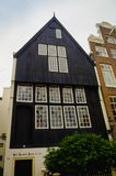 AMSTERDAM, NETHERLANDS, APRIL, 23 2018:Outdoor view of black wooden house in the begijnhof dowtown. In Amsterdam Stock Image