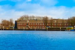 AMSTERDAM, NETHERLANDS, APRIL, 23 2018: Outdoor view of long brick building structure, is the capital and most populous. City of the Netherlands Amsterdam Royalty Free Stock Photos