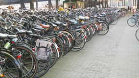 Amsterdam, Netherlands - April 21, 2019: Parking for bicycles. Many different bicycles parked on a street in special stock video footage