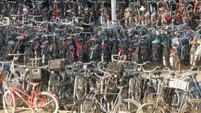 Amsterdam, Netherlands - April 21, 2019: Parking for bicycles. Many different bicycles parked on a street in special. Amsterdam, Netherlands - April 21, 2019 stock footage