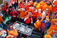 AMSTERDAM,NETHERLANDS-APRIL 27:  People dressed in orange celebrate King's Day on a boat on April 27,2015 in Amsterdam. Stock Photography