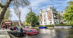 Amsterdam , Netherlands - April 31, 2017 : People getting on the sightseeing boat in the canals of Amsterdam Stock Photography