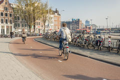 AMSTERDAM, NETHERLANDS - APRIL 22: People go to wo Stock Photos