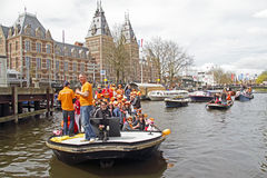 AMSTERDAM, NETHERLANDS - APRIL 30: People in orange celebrating Royalty Free Stock Image