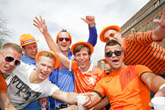 AMSTERDAM, NETHERLANDS - APRIL 30: People in orange celebrating. In Amsterdam during the coronation of the new king Willem Alexander from the Netherlands on 30 Royalty Free Stock Photos