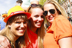 AMSTERDAM, NETHERLANDS - APRIL 30: People in orange celebrating Royalty Free Stock Photos