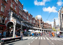 AMSTERDAM,NETHERLANDS-APRIL 27: Raadhuisstraat street on King`s Day with Westerkerk on the background on April 27,2015. Stock Photography