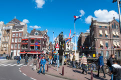 Amsterdam, Netherlands-April 30: Statue of Queen Wilhelmina, crowd of people and tourists on the street on April 30,2015. Stock Photo