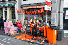 AMSTERDAM,NETHERLANDS-APRIL 27: Street musician on the street on King's Day on April 27,2015. Stock Photos