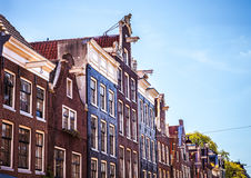 AMSTERDAM, NETHERLANDS - AUGUST 15, 2016: Famous buildings of Amsterdam city centre close-up. General landscape city  view Stock Photo