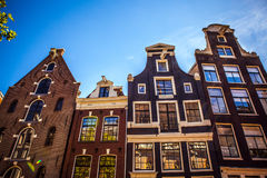 AMSTERDAM, NETHERLANDS - AUGUST 15, 2016: Famous buildings of Amsterdam city centre close-up. General landscape city  view Royalty Free Stock Photo