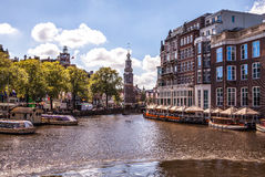 AMSTERDAM, NETHERLANDS - AUGUST 6, 2016: Famous buildings of Amsterdam city centre close-up. General landscape view of city street. S and traditional Dutch Royalty Free Stock Photography