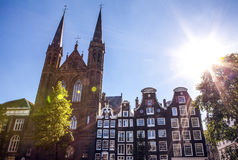 AMSTERDAM, NETHERLANDS - AUGUST 6, 2016: Famous buildings of Amsterdam city centre close-up. General landscape view of city street. S and traditional Dutch Stock Photo
