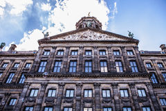 AMSTERDAM, NETHERLANDS - AUGUST 6, 2016: Famous buildings of Amsterdam city centre close-up. General landscape view of city street. S and traditional Dutch Stock Image