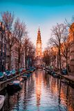Amsterdam Netherlands Beautiful Groenburgwal canal in Amsterdam with the Soutern church Zuiderkerk at sunset