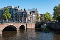 Amsterdam, The Netherlands, May, 2018: Beautiful and romantic view of the canals and typical houses from Unesco world heritage cit stock photography