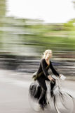Amsterdam,Netherlands. Blurred girl rides a bicycle in the afternoon Stock Photo