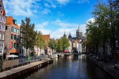 Canal in Amsterdam. Amsterdam is the Netherlands' capital, known for its artistic heritage, elaborate canal system and narrow houses with gabled facades stock image