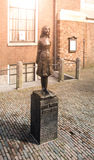 AMSTERDAM, NETHERLANDS - CIRCA APRIL 2009: Anne Frank Monument. Memorial statue of young Jewish girl - victim of. Holocaust - at Anne Frank`s House royalty free stock images